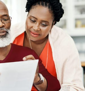 African American couple reviewing documents on their laptop